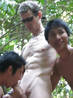 Cute Asian boys and white guy with huge cock in the forest