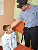 Handcuffed boy kneels down to please an older cop