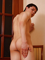 Tasty twink teasingly exposes his round back parts