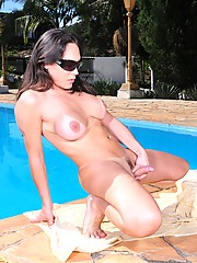 Superb Leticia Rodrigues posing outdoors by the pool