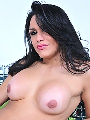 Sexy brunette tranny Ivana Spears exposing her hard cock