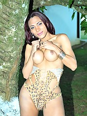 Transsexual Gysllene Rodrigues posing in the garden