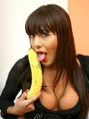 Latina Tranny eating a banana and comparing size with her cock