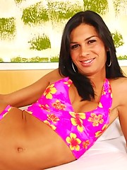 Hung Brazilian shemale with tanned boobs posing