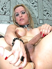 Ugly shemale inserting a huge double dildo in the ass touching her hard cock