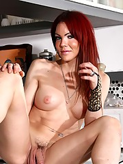 Transsexual redhead posing her fat cock in the kitchen