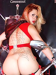 Hot tranny posing on a motorcycle