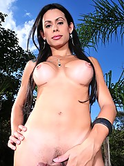 Sweet tranny Bruna posing outdoors