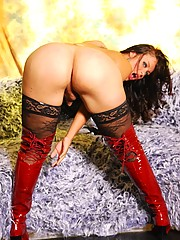 Busty Cinthia Martinelly in sexy high boots