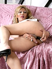 TS hottie playing with her big cock and asshole