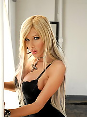 Hottie Kimber James posing in a hot black dress and heels
