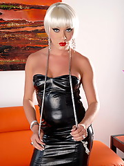 Sexy transsexual Mia Isabella in hot latex dress