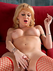 Seductive transsexual Olivia Love posing