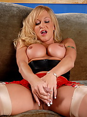 Busty transsexual Olivia Love posing her juicy cock and ass
