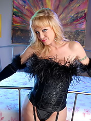Beautiful tgirl Olivia Love in sexy black corset