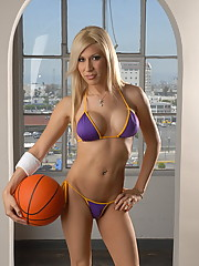 Irresistible Lakers fan posing in sexy bikini