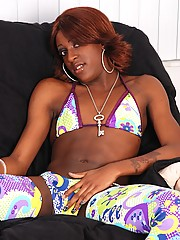 Ebony t-girl Blackberry was shy for her first time in front of the camera, but her cock definitely liked all the attention!