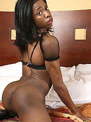 Ebony tranny Deja has got suck-able perky tits and a nice chocolate cock!