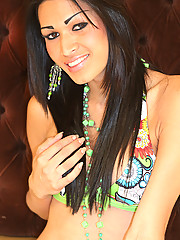 Renata is a beautiful brunette transsexual from Sao Paulo, she looks great in her bikini... but even better out of it!