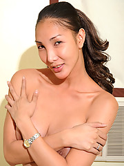 Ladyboy Khei has round perky breasts.