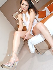 Korean shemale shows off her sexy legs and feet