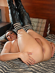 Alyssa is pouty lipped cutie from San Antonio with supple breasts and smooth, kissable skin. In this scene TS Alyssa is wearing some sexy striped thigh highs and leather boots. She spreads her legs on the bed and plays with herself.