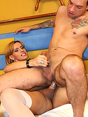 Brazilian Tranny Andriela Vendraminy found a perfect partner in Cladio because likes giving as much as receiving. After sucking his cock, she grabs his leg and shoves her she-cock inside of him. He cries out in ecstasy!