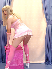 Sexy Candi in pink mini and thong playing with her cock