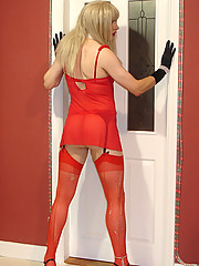 Candi wearing full red lingerie set and posing