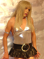 Mini skirt and silver leotard covers gorgeous Candi