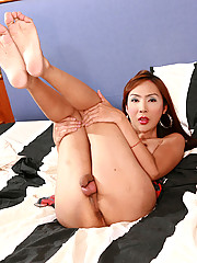 Cat is a horny ladyboy who nearly came all over herself when she was fingered in her tight she-pussy with three stiff fingers.