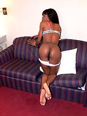 Hot black tgirl plays with herself on the couch