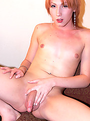 Sassy little blonde showing off her long hard cock.