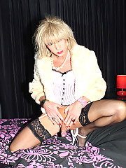 Tgirl Kim punishes her sexy ass with a monster strapon cock