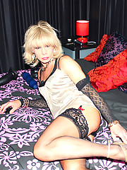 Beautiful crossdresser Kim teases her cock until its rock hard