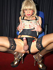 Horny tranny slut Kim wearing lingerie and playing with her ass.