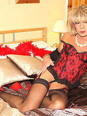 Crossdresser Kim looking gorgeous in a red basque