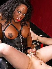 Mistress Janet Jaxxxson gets nasty with submissive slave Danny, forcing her cock down his throat.