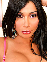 TS Vaniity strips out of her lingerie and stockings to show off that beautiful cock of hers