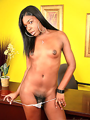 Black shemale strips and plays with her cock
