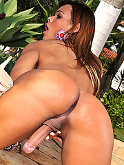 Busty shemale with a huge cock stripping