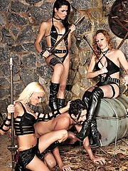 Three shemale dommes gangbang a submissive