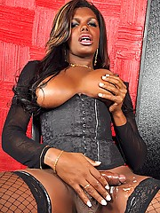 Black tgirl stroking in lingerie and heels