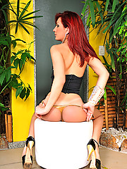 Gorgeous tranny redhead getting naked all alone