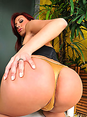 Redhead shemale showing off her ass and cock