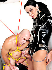 Shemale mistress in latex ties and fucks him