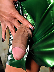 Shemale clad in metallic green latex