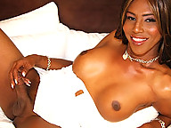 Paris is a stunningly beautiful black tgirl with soft tits and a long cock hiding beneath her white dress