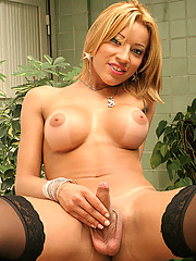 This hot blonde tranny gets creamed up in these hot pics