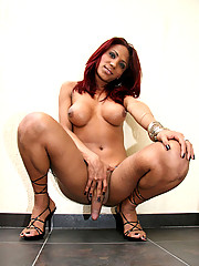 This cute tranny gets her face and titties all creamed up after her man douses her with cum